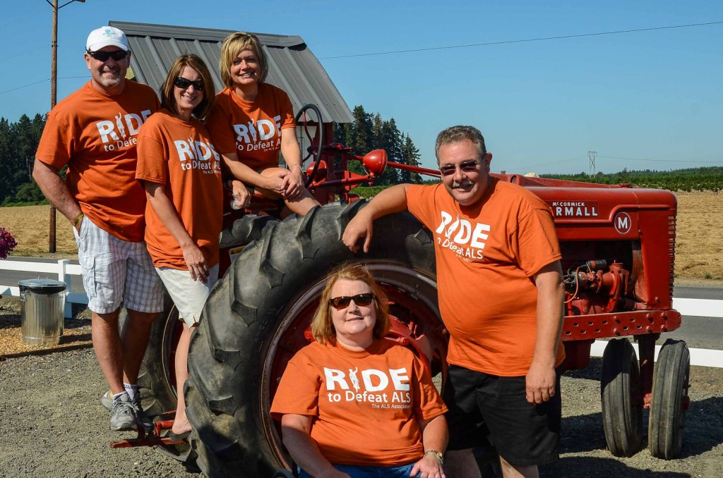 2014 Ride volunteers on tractor